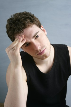 worried gesture pain young man stressed headache portrait photo