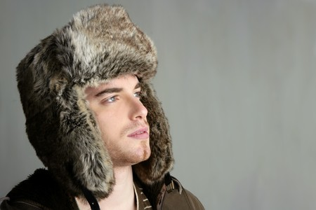 winter fur hat portrait of fashion young handsome man photo