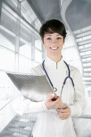 modern future doctor woman stethoscope and silver folder photo