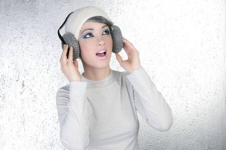futuristic fashion future woman hearing music silver headphones photo