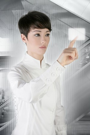 futuristic businesswoman finger touch pad on modern office photo