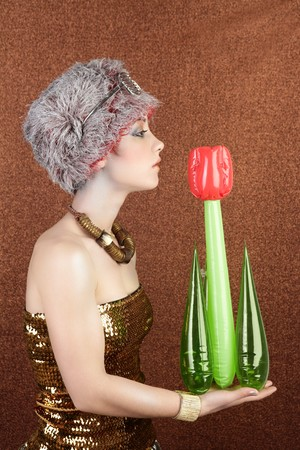 surreal fashion futuristic woman holding plastic tulip red flower Stock Photo - 6987230