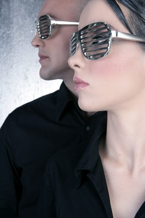 futuristic girl: futuristic silver glasses couple portrait profile fashion future metaphor  Stock Photo