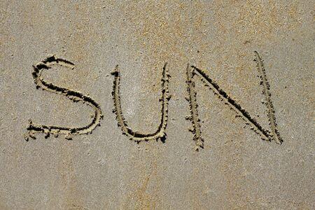 word sun spell on beach wet sand such a summer vacation metaphor Stock Photo - 7102680