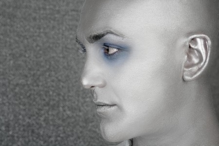 silver alien man profile portrait extraterrestrial male metaphor Stock Photo - 7097568