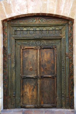ancient eastern indian polychrome wooden entrance door photo