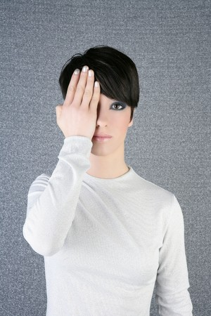 modern fashion woman portrait hand hide eye silver background photo