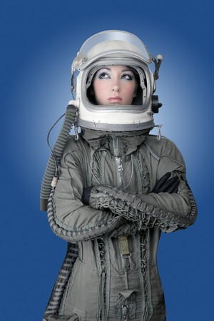 astronaut: aircraft  astronaut spaceship helmet woman fashion portrait over blue Stock Photo