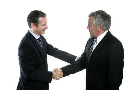 adult businessman handshake expertise portrait dark suit white background Stock Photo - 7239932
