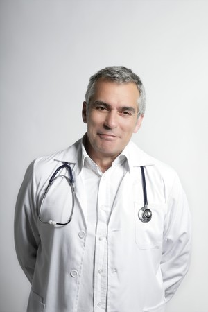 expertise doctor senior gray hair smiling portrait photo