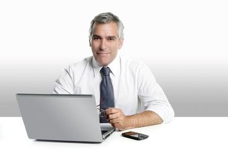 businessman senior gray hair working laptop computer white desk background Stock Photo - 7239843