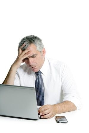 worried executive: angry sad senior gray hair businessman laptop computer hand gesture