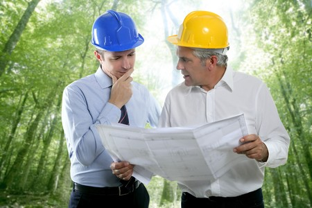 architect engineer two expertise team plan talking hardhat forest jungle trees Stock Photo - 7239961