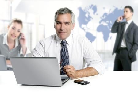 businessman senior expertise teamwork world map global communication