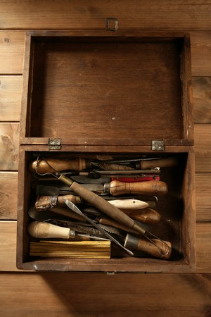srtist hand tools for handcraft works on golden wood background photo