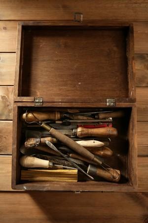 srtist hand tools for handcraft works on golden wood background photo