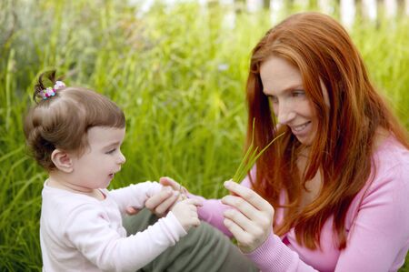 baby and redhead mother outdoor grass playing park together Stock Photo - 7240339