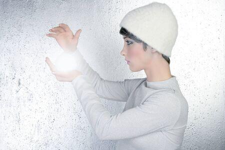 futuristic fashion fortune teller woman light glass sphere future ball  photo