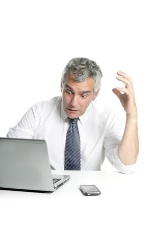 angry sad senior gray hair businessman laptop computer hand gesture photo