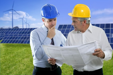 construction project: architect engineer two expertise team plan talking hardhat solar plates meadow grass