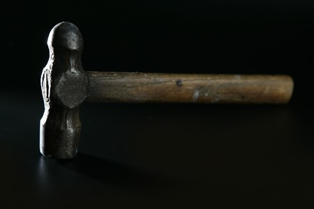 Hammer  selective focus over black background Stock Photo - 7310112