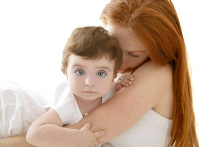 baby brunette and redhead mother love hug on white photo