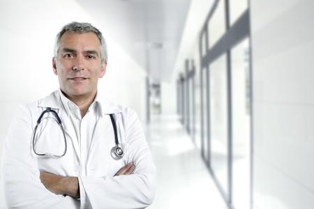male doctor: gray hair expertise handsome senior doctor hospital portrait white corridor