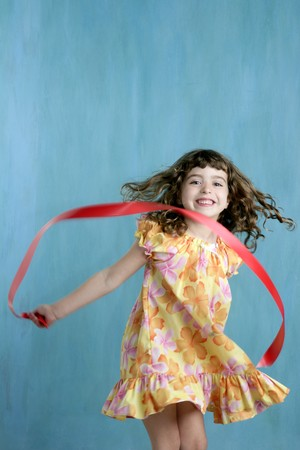 action little girl red ribbon tape dancing over green motion