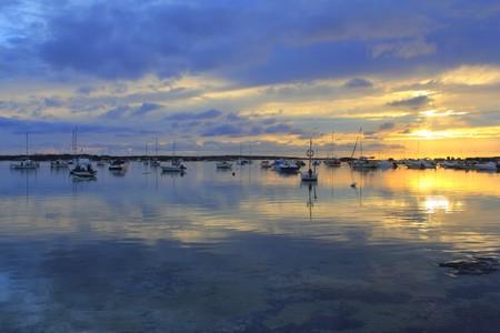des: Estany des peix lake yellow blue sunset in Formentera Balearic islands