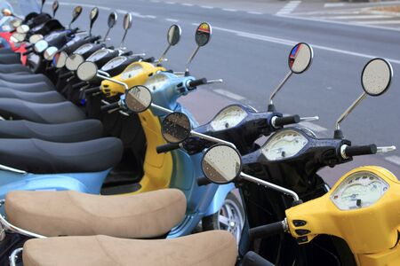 motor scooter: scooter motorbikes row many in rent store