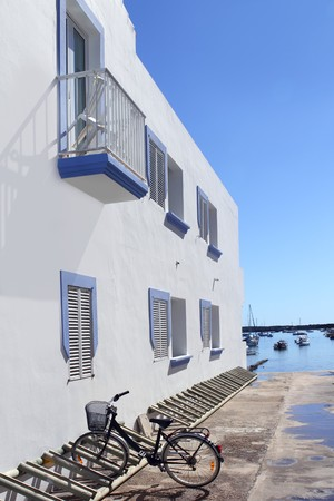 white house bicycle Formentera estany des peix blue day Balearic Islands photo