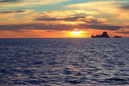 vedra: ibiza sunset Es Vedra from Formentera balearic Islands Stock Photo