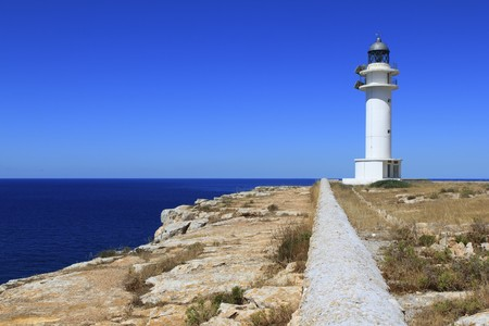 Barbaria lighthouse formentera Balearic islands blue sunny mediterranean day photo