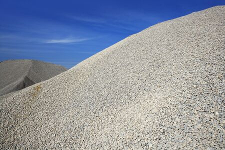 large formation: gravel gray mound quarry stock blue sky rolling stones