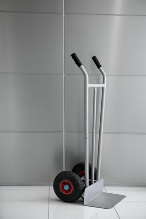 boxes barrow vertical trolley silver gray background photo