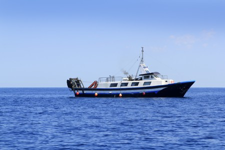trawler fisherboat boat working in mediterranean offshore blue water photo