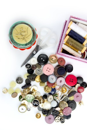sewing stuff buttons nails thread scissors mixed still life on white photo