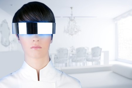 futuristic girl: silver futuristic glasses woman modern white house interior living room Stock Photo