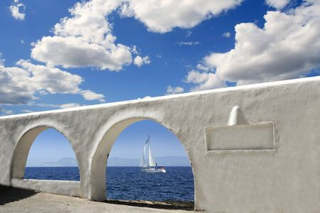 mediterranean sea view white archs architecture blue sky photo