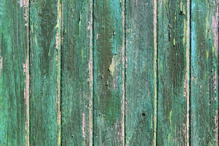 aged weathered green wooden paint door texture background photo