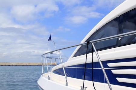 blue yacht side view Formentera port Balearic islands photo