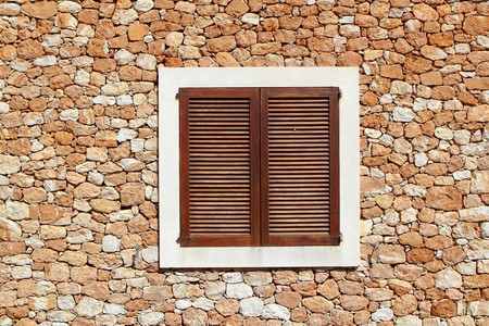brown wooden window in masonry wall balearic islands Stock Photo - 7455927