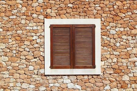 brown wooden window in masonry wall balearic islands Stock Photo - 7455927