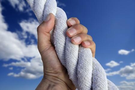 man hand grab grip strong climbing to sky big rope metaphor photo