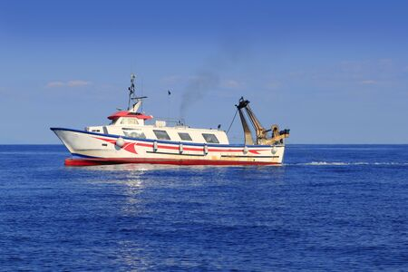 trawler fisherboat boat working in mediterranean offshore blue water