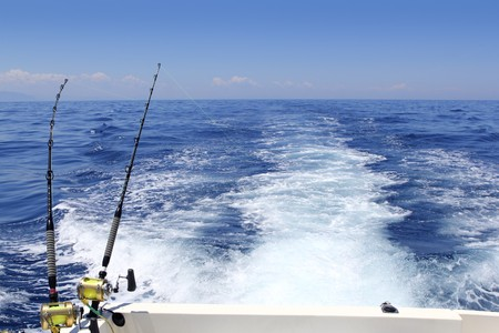 despertarse: mar azul pesca d�a soleado de arrastre de vara carretes estela oc�ano gran juego