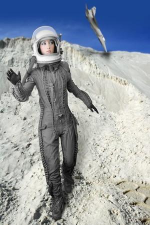 astronaut fashion womanaircraft crash space suit helmet moon landscape Stock Photo - 7516007