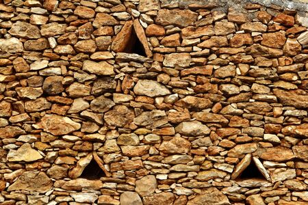 masonry stone wall triangle windows Formentera balearic islands Stock Photo - 7516167
