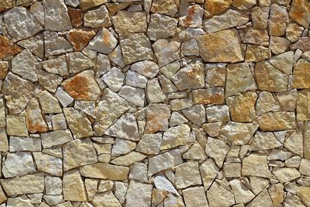 masonry stone wall rock construction pattern texture background Stock Photo
