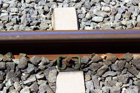 iron rusty train railway detail over dark stones rail way photo